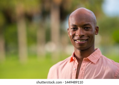 Portrait of a sucessful young African American businessman in a pink shirt unbuttoned