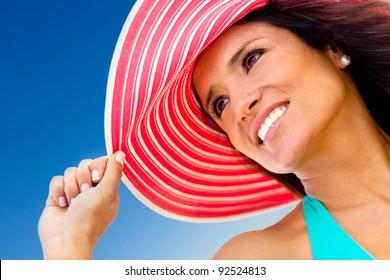 Portrait of a summer girl wearing a hat