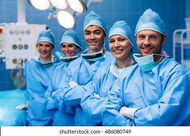 Portrait of surgeons standing in operation room at the hospital. Healthcare workers in the Coronavirus Covid19 pandemic