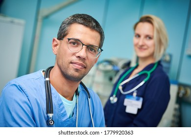 Portrait of surgeons team in hospital.  male and caucasian female doctors