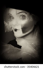 Portrait of the surprise mime in a veil