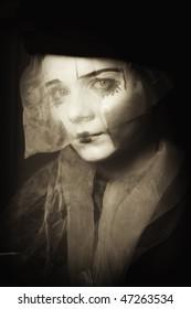 Portrait of the surprise mime in a veil close up monochrome