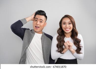 Portrait surprised asian couple.