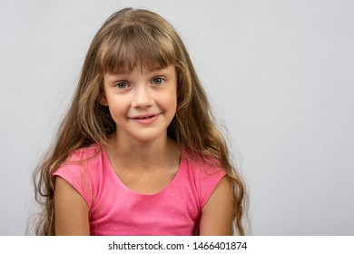 Portrait of a surprised beautiful eight-year cheerful European girl