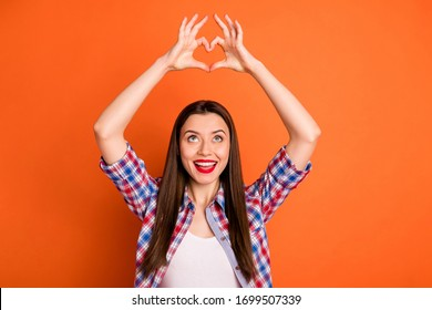Portrait of surprised crazy positive girl make fingers heart sign love symbol look enjoy wear stylish clothes isolated over bright color background