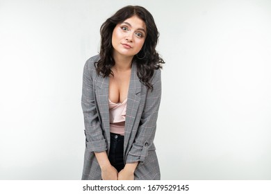 portrait of a surprised girl in a gray checkered jacket on a white studio background