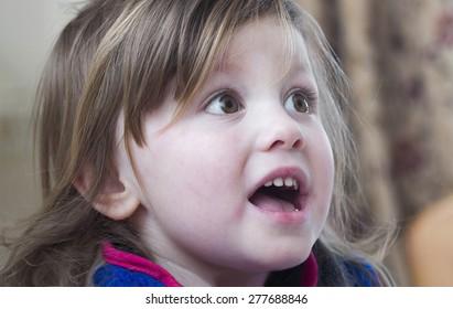 Portrait of a surprised little girl