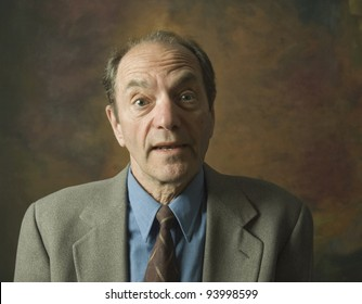 portrait of surprised man looking at camera