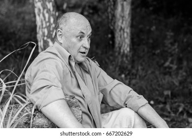 Portrait  surprised mature man in  casual style on outdoors