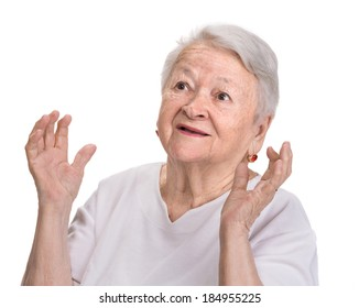 Portrait of surprised old woman on a white background
