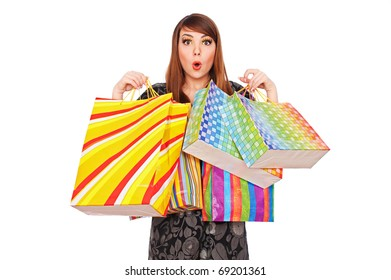 portrait of surprised woman with shopping bags over white background