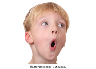 Portrait of a surprised young boy  on white background