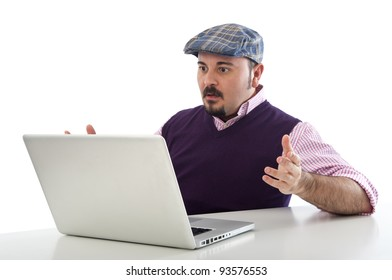 Portrait of a surprised young man looking at laptop against whit