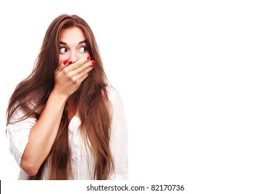 Portrait of a surprised young woman with hands over her mouth