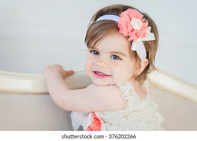 Portrait of a sweet baby girl with a flower on her head