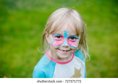 Portrait of sweet child with face painting