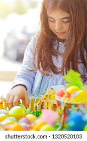 Portrait of a sweet little baby girl having fun on Easter holiday celebration, making Easter crafts, happy religious holiday