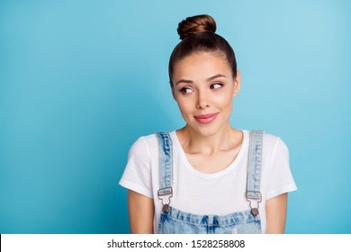 Portrait of sweet person looking wearing white t-shirt denim jeans overalls isolated over blue background
