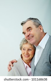 Portrait of a sweet senior couple isolated on grey background