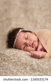 Portrait of sweet sleeping baby on soft blurred background