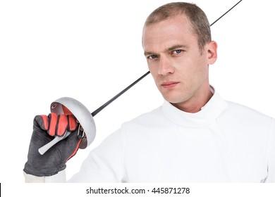 Portrait of swordsman holding fencing sword on white background
