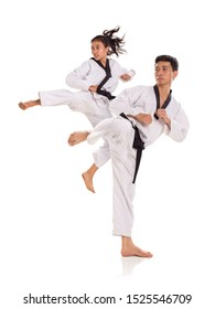 Portrait of tae-kwon-do team in action pose. Combat sports concept. Full length shot, isolated over white background