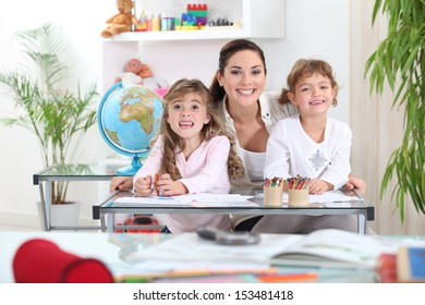 Portrait of a teacher with her pupils