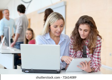 Portrait of teacher and teenage girl in computing class
