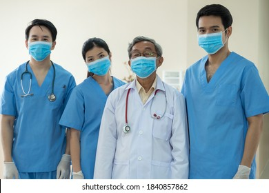 Portrait team Asian Doctors with face masks - Shutterstock ID 1840857862