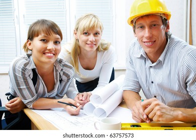 Portrait  the team of engineers working on construction project at the table