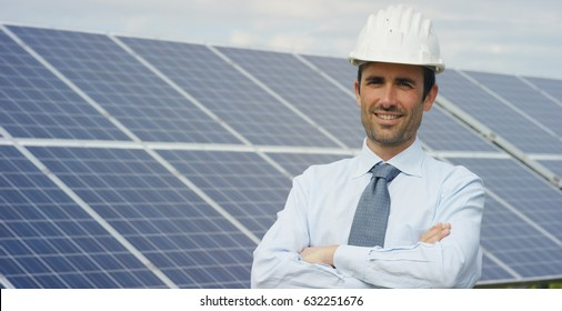 A portrait technical expert in solar photovoltaic panels, remote control performs routine actions for system monitoring using pure renewable energy. The concept of remote support technology, ecology.