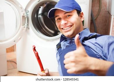Portrait of a technician repairing a washing machine