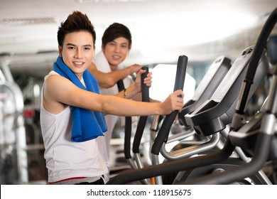Portrait of teen athletes working out in a gym