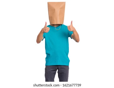 Portrait of teen boy with paper bag over head making thumb up  gesture, isolated on white background. Child showing success sign.