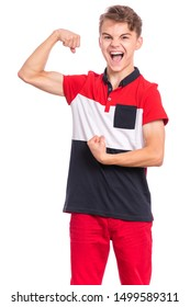 Portrait of teen boy raised his hands and shows biceps, isolated on white background. Handsome teenage young boy shows biceps screaming. Shouting strong child flexing biceps and looking at camera.