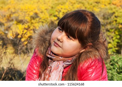a portrait of teen girl with autumn background