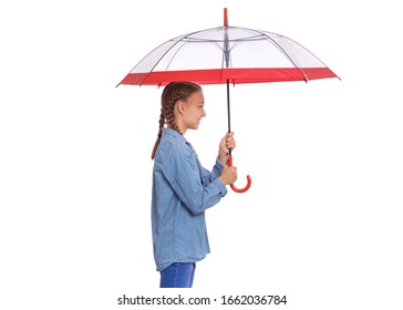 Portrait of teen girl holding umbrella - side view, isolated on white background. Happy child with umbrella for autumn rainy day. Cute caucasian young teenager smiling and looking away - profile.