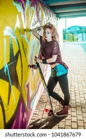 portrait of teen girl with long skate board stand against gray wall. Outdoors, urban lifestyle. Empty space for inscription. Youth subculture. hand hold skateboard or long board. sunny day