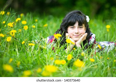 Portrait of a teen girl lying in the grass
