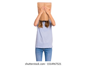 Portrait of teen girl with paper bag over her head with hands on face covering eyes, isolated on white background. Shy child pulling paper bag over her head close eyes with palms. See no evil concept.