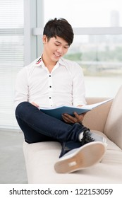 Portrait of a teen reading on sofa