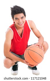 Portrait of a teenage boy with basketball looking at camera and smiling