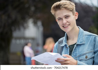 Portrait Of Teenage Boy Happy With Exam Results