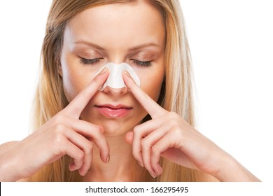 Portrait of teenage girl applying clear-up strips on nose