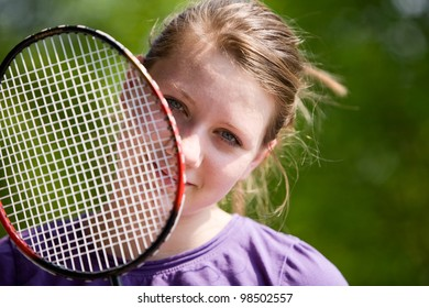 Portrait of teenage girl with badminton racket