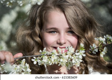 Portrait of a teenage girl in blossoming cherry trees