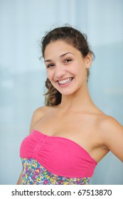 portrait of a teenage girl with braces smiling