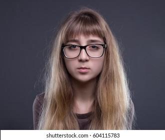 Portrait of teenage girl in glasses