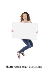 Portrait of a teenage girl jumping against white background with a placard.