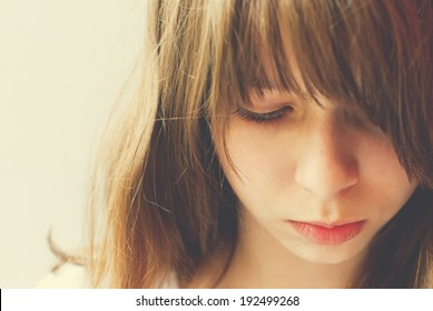 Portrait of Teenage Girl, looking sad, toning effect, closeup